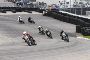 Racers at the USCRA Vintage Grand Prix take a hard turn at the New Hampshire Motor Speedway