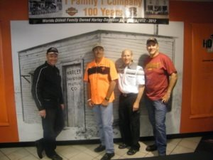 Scott Miller, Mark and Karl Kegel, and Matt Levatich in front of the original factory entrance photo