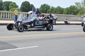 Afghanistan POW Bergdahl's parents ride in a custom hot rod during Rolling Thunder XXV