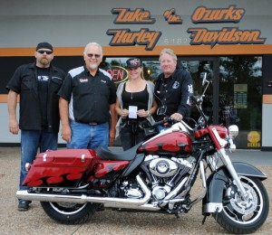 Brent Bouren and Jack Fleming, owner of Lake of the Ozarks H-D, with Passport Run bike winner Stacey Satterwhite and her husband, Jeff