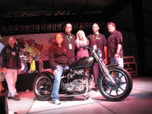 A very happy Monica Stacy, winner of the raffle bike built by Loaded Gun Customs