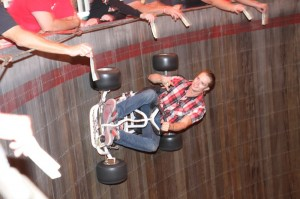 Sparky J. Lightnin' takes the go-cart for a spin around the Wall of Death