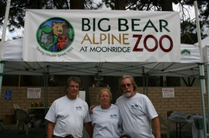 Run for the Grizzlies sponsors Tom, Joy and Jack take a timeout from their hard work