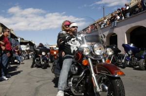 Crowds gathered on balconies and along the streets to watch riders cruise the boulevard