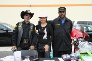 """Thomas """"TC"""" Costley, Jan """"Sunny"""" Emanuel-Costley and Youngblood staff the Divas for a Cure table"""