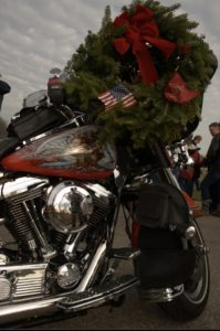 A wreath rests on a firefighter's motorcycle before being placed