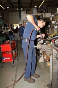 Dave Zehner drills new bungholes in the Switchback exhaust for the new oxygen sensors
