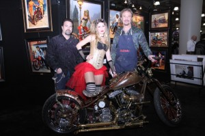 Builder Copper Mike, model Jennie Villano and artist David Uhl with the Steampunk Bike that inspired Uhl's painting Steampunk Seduction