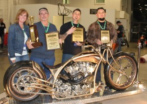 """Three in a row: Dawndra and Sam baldi (owners), with builder Jimmy Todorovitch, painter Alberto Ahumada and """"Nemesis,"""" America's Most Beautiful Motorcycle"""