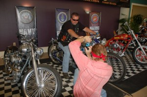 Jay Allen helping a veteran capture a moment on Billy Lane's Air Force Bike