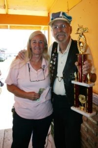 Butthead Jim awards the grand trophy to Joy Mattice for her $120 donation to the Yuma Burn Center