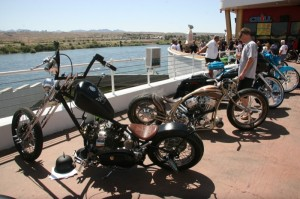"""Bikes bask in the sun near the shores of the Colorado, but one stood out from the crowd--Sam and Dawndra Baldi's """"Nemesis"""" (second from left) took Best of Show at the Colorado Belle"""
