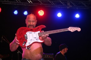 Musicians were asked to sign the guitar that was raffled off on Saturday night