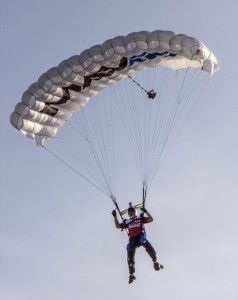 A member of the Lucas Oil Parachute Team drops in on WCT