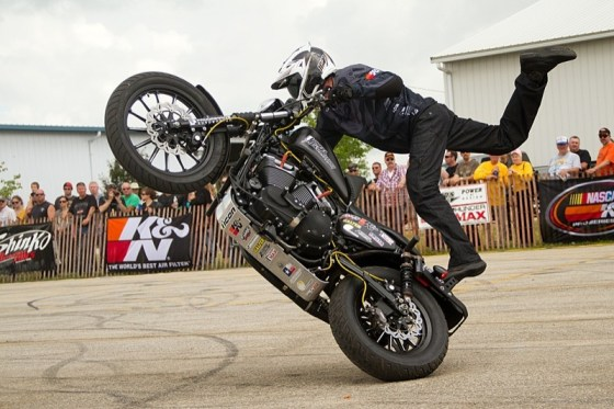 Rob Carpenter from 1 Wheel Revolution performs a stand-up circle wheelie on a Sportster