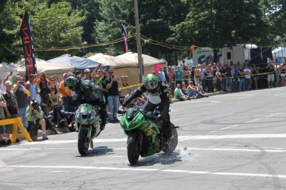 Jason Britton and Eric Hoenshell of Team No Limits recycle a few soda cans