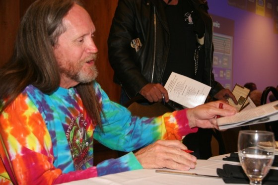 Master bike builder Rick Fairless signs autographs for appreciative fans after the awards ceremony in Deadwood
