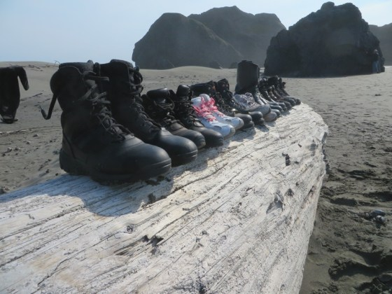 The group's boots are lined up at Pistol River State Park in Oregon, carrying out the theme started in Atlantic City