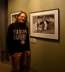 Bill Rodencal, Harley-Davidson Museum head restorer and conservator, stands near one of his favorite prints