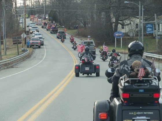 Patriot Guard Riders follow behind the firefighter escort en route to Arlington