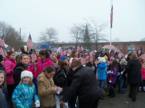 Students at Pine Grove Elementary School in Rowley, Massachusetts, greet the escort