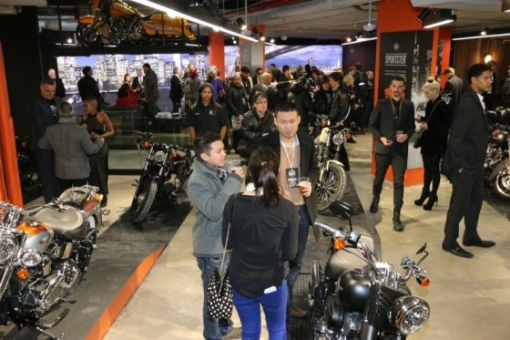 Partygoers mingle throughout the spacious lower-level showroom at H-D of NYC
