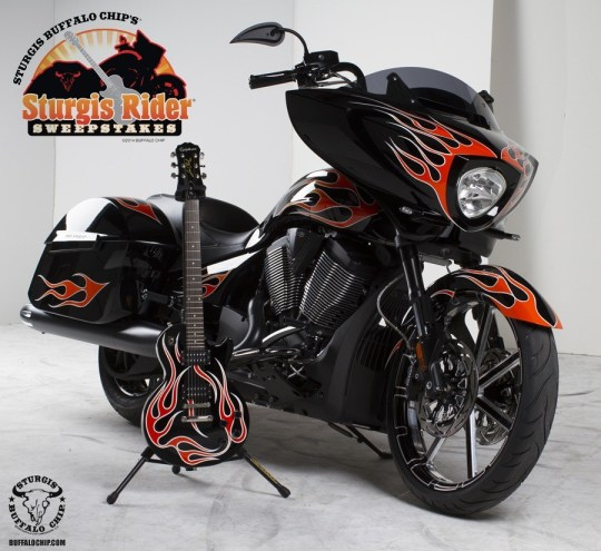 The Ness-customized Victory Cross Country 8-Ball  and matching Epiphone guitar for Buffalo Chip's 2014 Sturgis Rider Sweepstakes