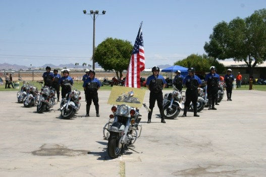 The VMMV began their performance with a tribute to Commander Harry Fisher and his '51 Panhead