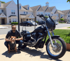 Anthony Ungaro with his '07 FXDB and pit bull buddy Donnie