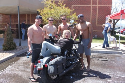Masyn Moyer is ready for the soapy suds from the Colorado Calendar Firefighters