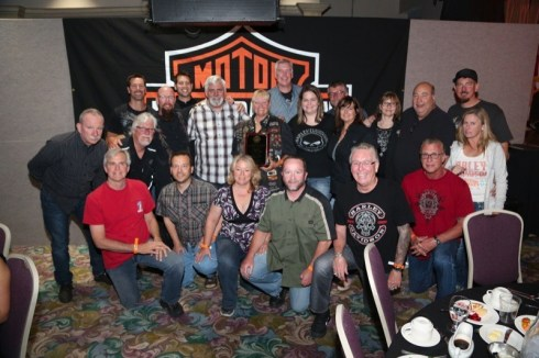 """The SoCal H-D Dealers Association presents Jeanne """"JJ"""" Jaite (center, with plaque) with the Rider of the Year award for reaching the 200,000-mile mark on her original 1998 FXSTC"""