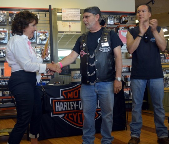 SHAREing & CAREing's Anna Kril accepts a $9,193 check from NYC H.O.G. member Jeff Gold