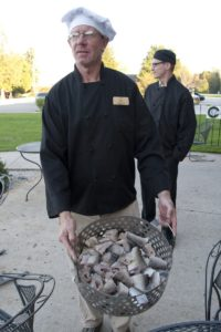 The vintage flavor of Rowley's Bay Resort includes a traditional Scandinavian fish boil cooked outside over an open fire (www.rowleysbayresort.com)