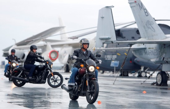 Tamika Whitfield, member of the U.S. Air Force, from Charleston, rides the H-D Street 500 aboard the USS Yorktown, in Mt. Pleasant, S.C., as Harley-Davidson announced it is offering free Riding Academy to all current and former U.S. Military. (Mic Smith/AP Images for Harley-Davidson)