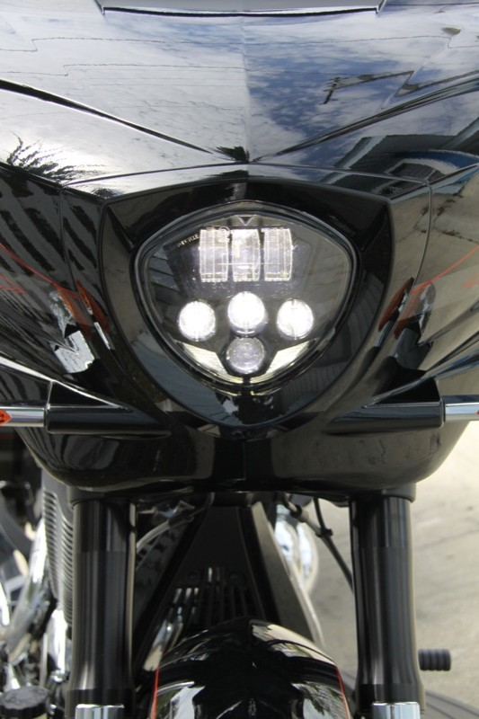 The new LED triangular headlamp lends a Batman/Dark Knight touch to the X-1