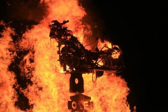 A Suzuki Intruder goes up in flames at Saturday Night's Burning of the Bike Ceremony