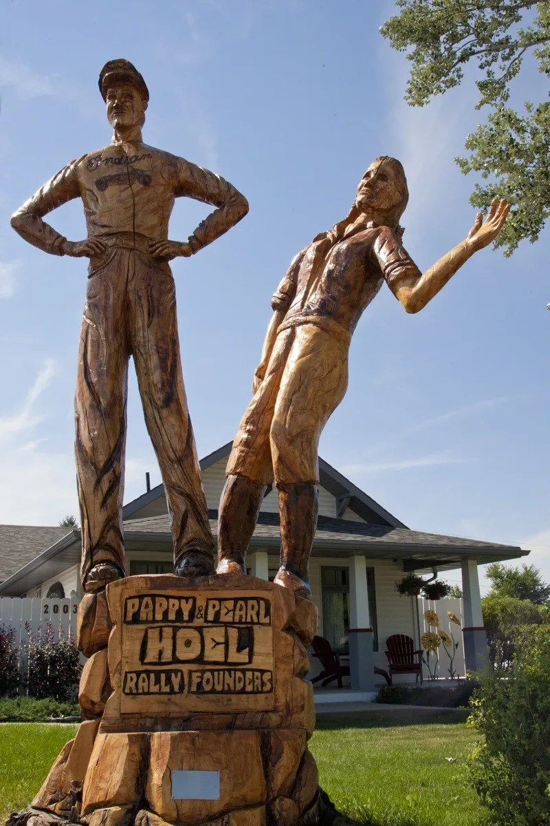 """A tree carving honors rally founders J.C. """"Pappy"""" Hoel and his wife Pearl in front of the family homestead on Junction Street in Sturgis"""