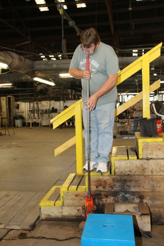 A glassblower demonstrates his craft at Blenko Glass, which produces a variety of stunning glass works