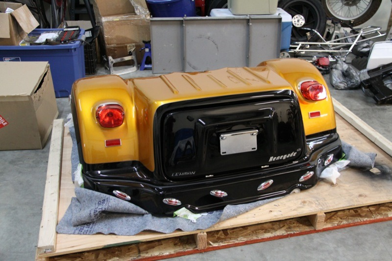 "The Champion ""Renegade"" assembly has integrated fenders and a hinged trunk capable of carrying 500 pounds"