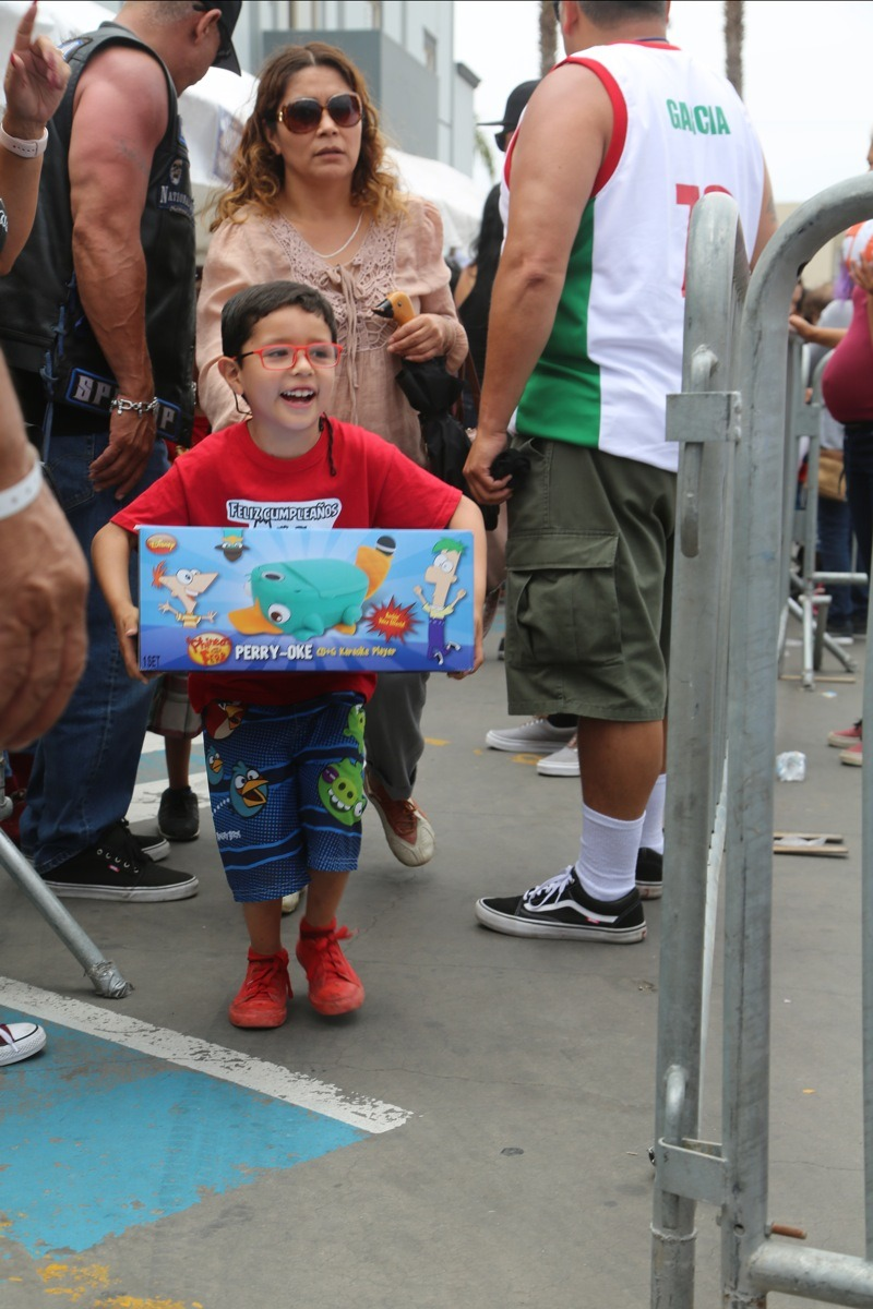 A young boy was beaming with joy after receiving his toy