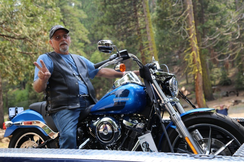 Ron Easton from Crystal Falls was overjoyed when his ticket was called for the grand prize which was an Electric Blue 2018 Softail Low Rider