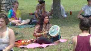 Priya plays her Hummingbird Drum