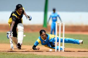 A Sri Lanka Army Ladies bowlers attempts to run a Northern Ladies batsman out in Vavuniya