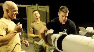 USAF armament technicians connect a guidance unit to a 453kg bomb