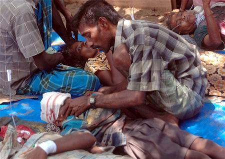 Injured civilians lie on the ground in a make-shift hospital in this photograph released by the pro-Liberation Tigers of Tamil Eelam (LTTE) group 'Mercy Mission to Vanni' on April 20, 2009 showing what they say are wounded civilians who were fleeing from an area still controlled by the LTTE in the 'No Fire Zone' near the village of Putumatalan in Puthukkudiyirippu, northeastern Sri Lanka. REUTERS/Mercy Mission to Vanni/Handout