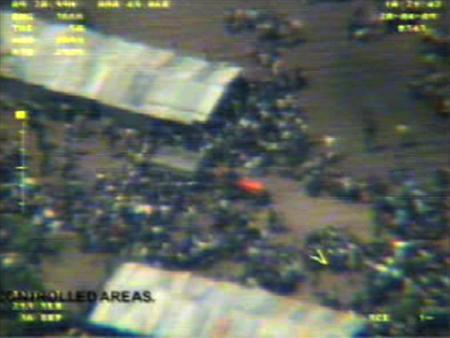 A video grab taken from an unmanned aerial vehicle and released by the Sri Lankan government shows thousands of people the military said fled an area held controlled by the Tamil Tiger separatists in northeastern Sri Lanka on April 20, 2009. REUTERS/Sri Lankan Government/Handout