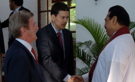 In this handout picture released by The Sri Lankan Presidential Office, French Foreign Minister Bernard Kouchner (L) looks on as his British counterpart David Miliband (C) shakes hands with Sri Lankan President Mahinda Rajapaksa (R) as they arrive for a meeting at Ambilipitiyasits on April 29, 2009. British foreign minister David Miliband and his French counterpart Bernard Kouchner who are in Sri Lanka for a one-day visit have failed to secure an agreement from Sri Lanka to end an offensive against Tamil rebels and allow humanitarian access to civilians trapped by the fighting. AFP PHOTO/HO/Sri Lankan Presidential office RESTRICTED TO EDITORIAL USE GETTY OUT (Photo credit should read HO/AFP/Getty Images)