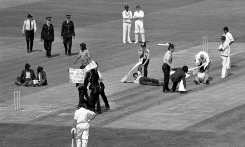 DEMO Police in action at The Oval, when about 20 demonstrators rushed onto the pitch during Sri Lanka's match against Australia. They were protesting against Sri Lanka's team choice being racially biased