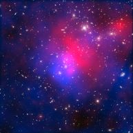 Pandora's Cluster showing x-rays and dark matter - The galaxies in the cluster make up less than five percent of its mass. The gas (around 20 percent) is so hot that it shines only in X-rays (colored red in this image). The distribution of invisible dark matter (making up around 75 percent of the cluster's mass) is colored here in blue