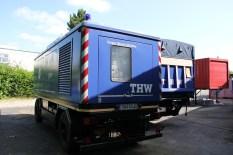 315 kVA Rückansicht mit LKW und Container